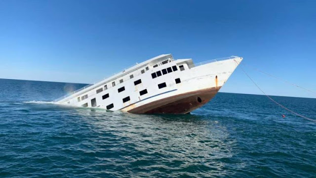 the 215-foot-long cruise ship American Glory of American Cruise Line  slips below the surface of the Atlantic Ocean off the Delaware coast on