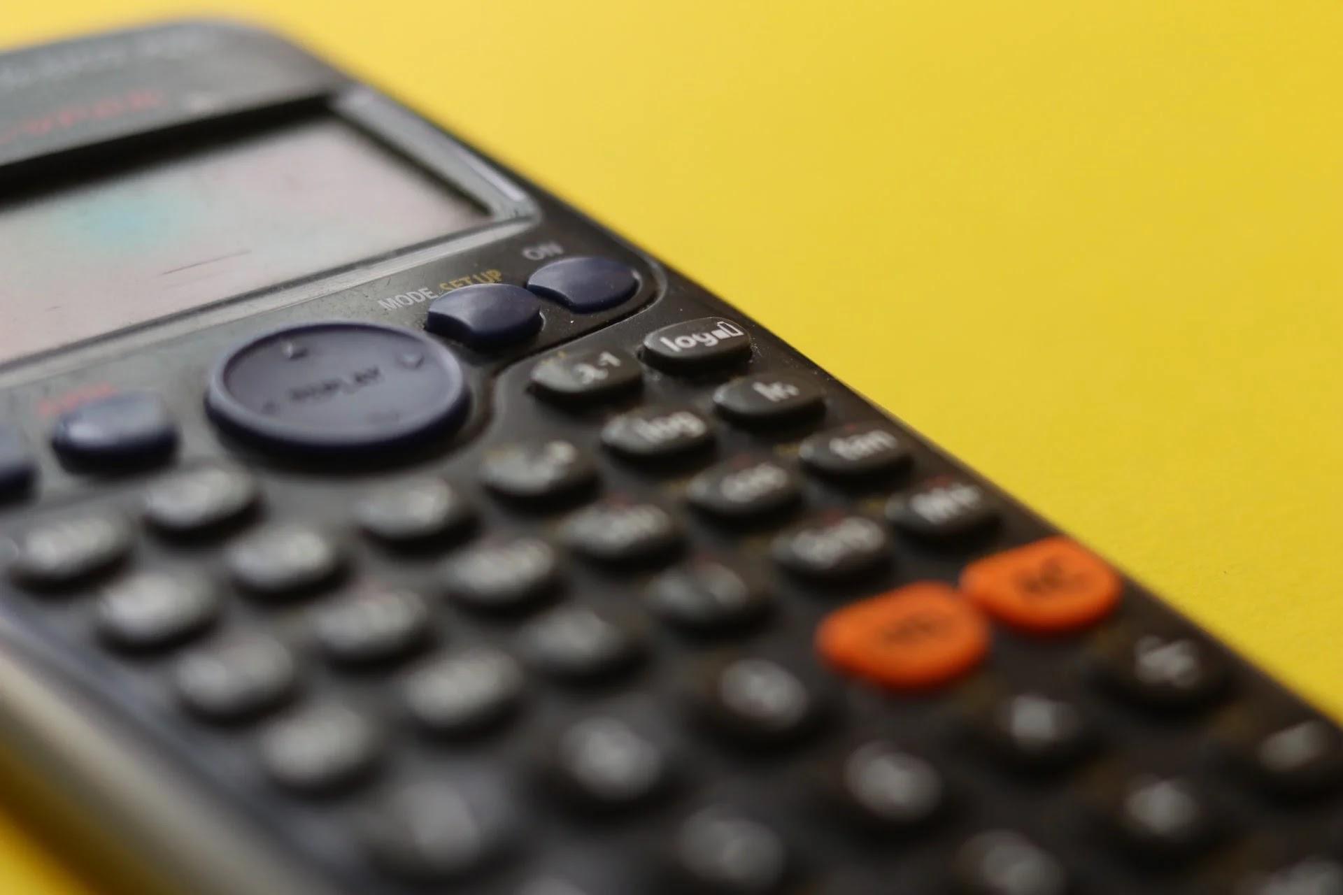 calculator on yellow table