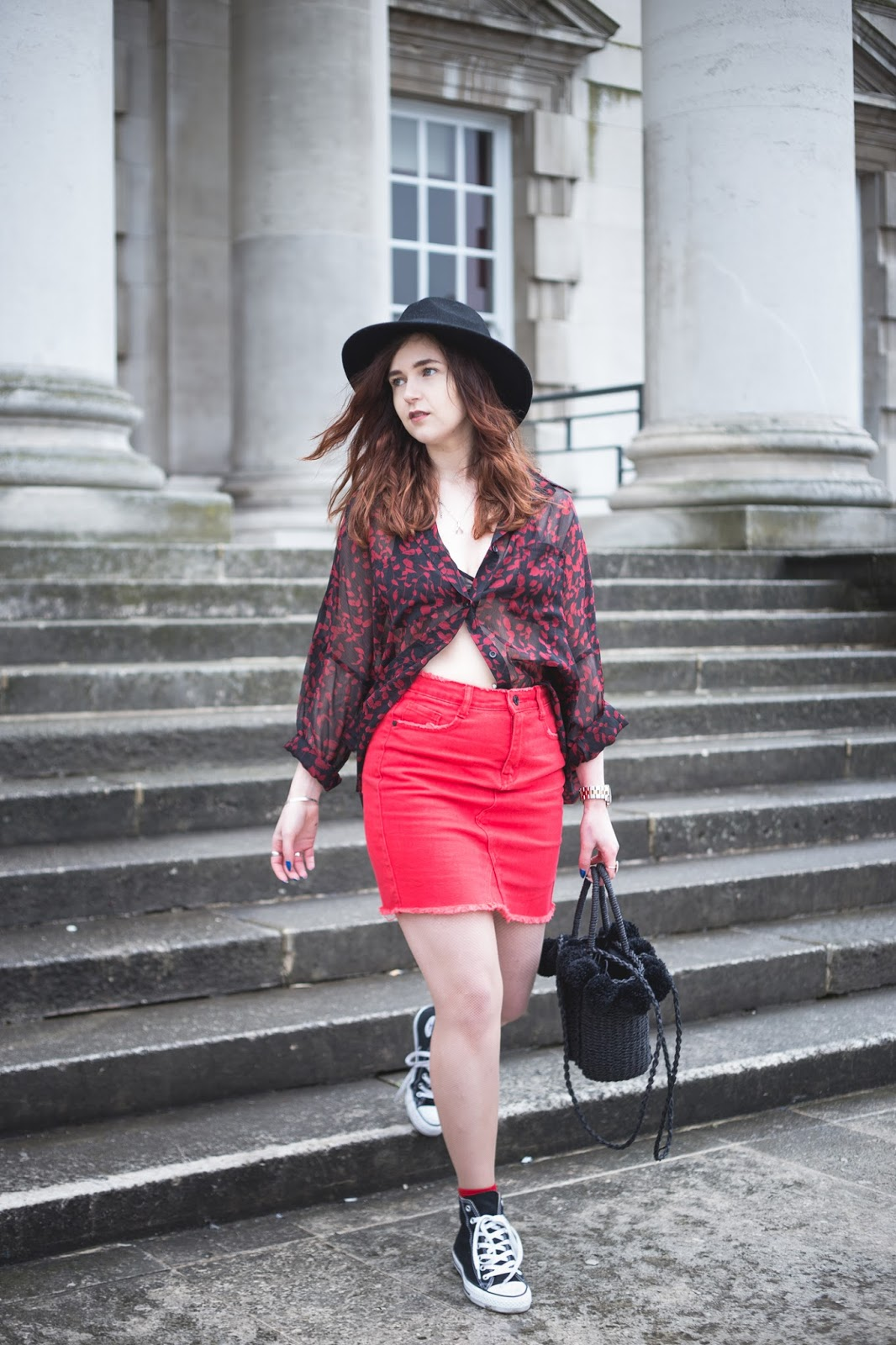 red skirt and straw bag