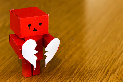 paper robot with a broken heart