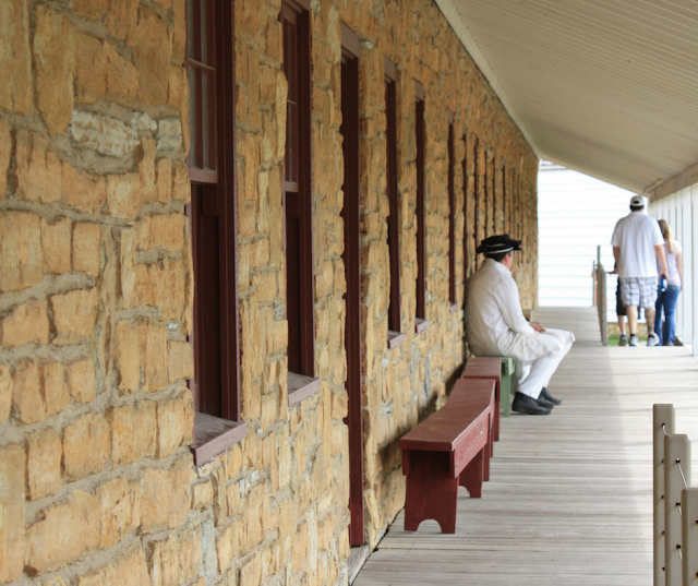 Interpreters resting at Fort Snelling before muster