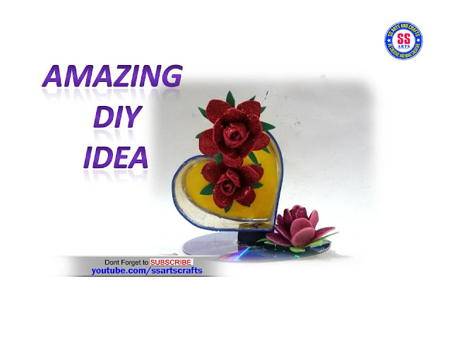 Here is cd crafts,how to make things from old cd or dvd's,valentine's day special gift making with recycled materials,crafts with old cd,how to make things from recycled crafts,cd wall art,room decor ideas using recycled cd,wall hanging ideas for recycled cd or dvd,kids projects using old cd,how to make gift articles from cd,plastic bottle show piece,how to mke things from plastic bottle,how to make heart show piece from plastic bottle and CD ss arts crafts nanduri lakshmi youtube channel videos