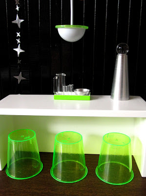 Modern one-twelfth scale miniature scene of a bar in black and white with lime details, decorated for Christmas.