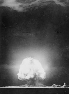 The eerie mushroom cloud formed by the  first test explosion of an atomic bomb