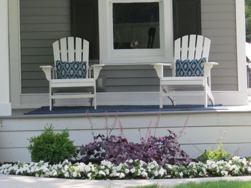 flower garden and lawn chairs on porch