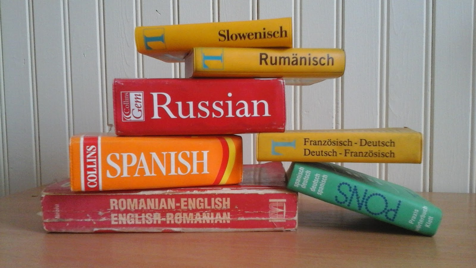 dictionaries for foreign languages stacked on top of each other for blog post about foreign language war movies