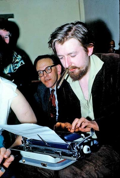 A young Michael Moorcock, typing 20,000 words, wherever he might be