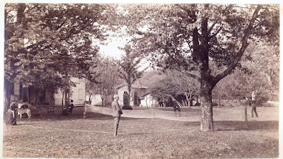 John and Helen Reily and guests (circa 1890s) playing badminton in the side yard of the house