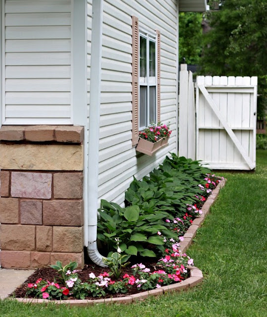 small area for flowers around the outside of the home