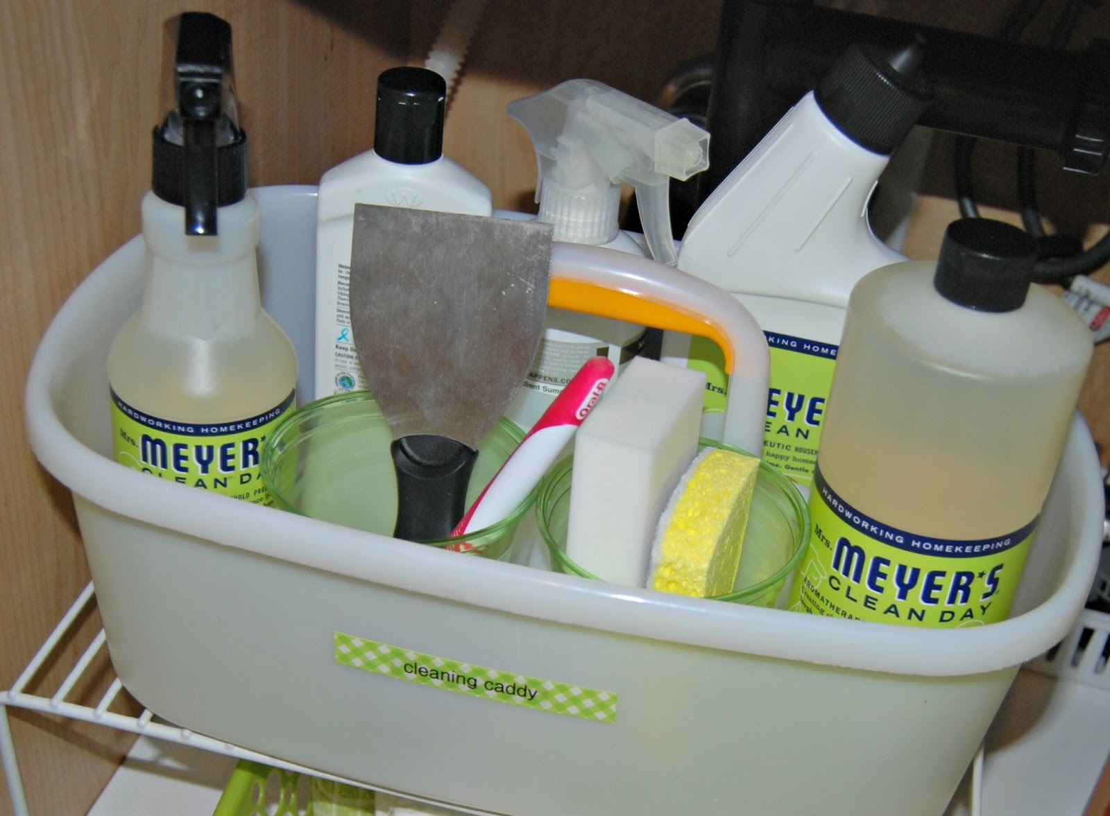 10 Steps for Organizing Under Sink Kitchen Cabinets - Sweet Shoppe on cleaning marble sink, cleaning up kitchen, cleaning kitchen table, cleaning kitchen utensils, cleaning kitchen drawers, cleaning kitchen cupboards, cleaning kitchen cabinets with tsp, cleaning kitchen dishwasher, cleaning kitchen furniture, cleaning copper sinks, cleaning kitchen floor, cleaning kitchen grill, cleaning kitchen counter, cleaning kitchen faucet, cleaning kitchen microwave, cleaning kitchen hood, fish cleaning sink, cleaning toilet, cleaning granite sink, cleaning kitchen pots,
