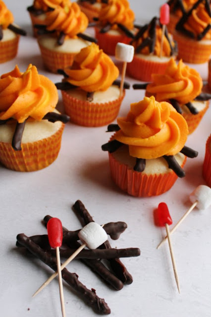 campfire cupcakes with pretzel twigs, and candy marshmallow and hot dog decorations