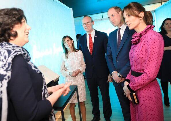 Kate Middleton wore a vintage polka-dot print and ruffle neckline dress by Oscar De La Renta, carried Jimmy Choo Celeste clutch