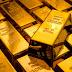 Gold slips on strong dollar but weak U.S. data caps losses