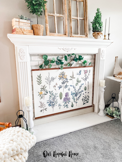 chunky knit throw baskets books botanical print fireplace