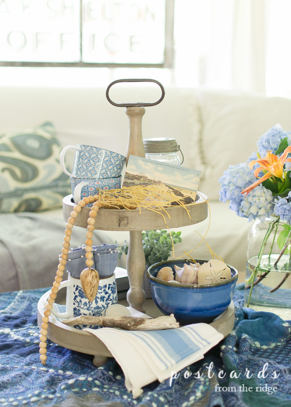 2 tiered wooden tray with blue coastal decor