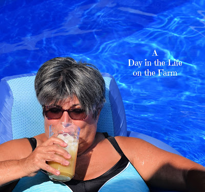 woman drinking cocktail in pool