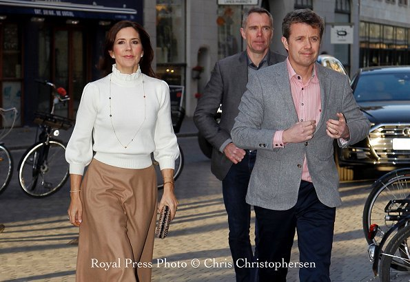 Crown Princess Mary wore CO essential wool sweater, carried Bottega Veneta clutch.
