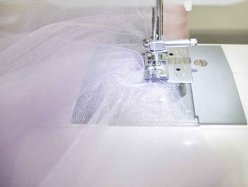tulle layers being held together with a basting stitch
