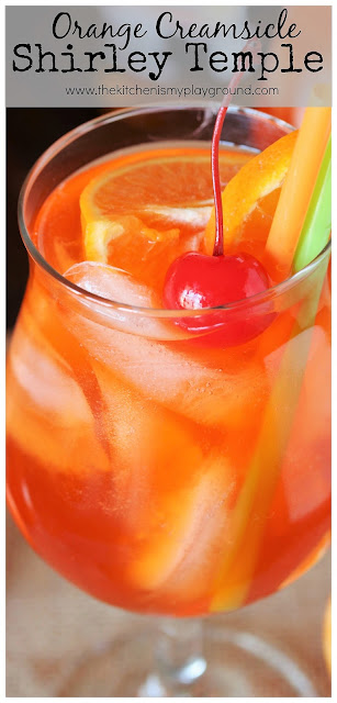 Orange Creamsicle Shirley Temple ~ Orange-y, tasty & easy to make. This sure is one pretty mocktail to add to your #mocktail line-up. It's just plain fun to drink! #shirleytemple #orangecreamsicle #drinks #kiddrinks #fundrinks #orangesoda #thekitchenismyplayground  www.thekitchenismyplayground.com