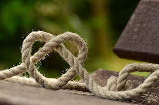 A rope, knotted such that the knot makes a heart shape.