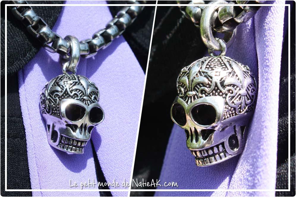 bijou composé d'un pendentif crâne avec ornement surmontés de fleurs