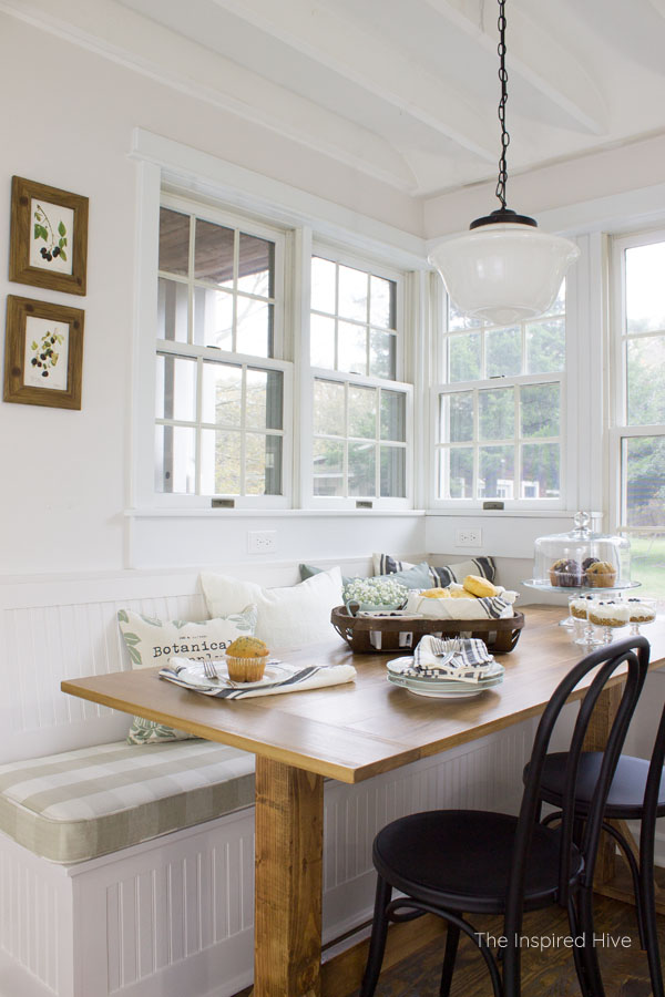 Farmhouse breakfast nook with schoolhouse light