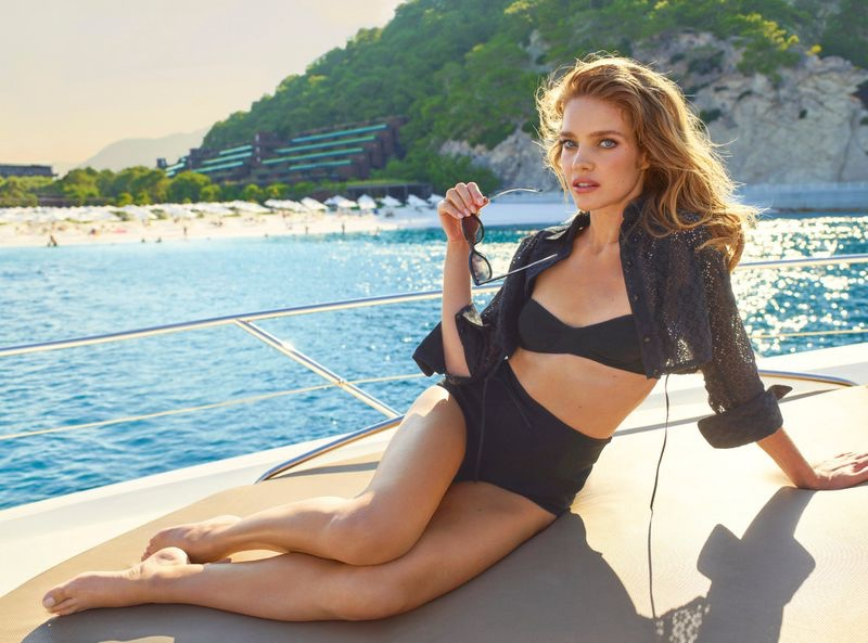 Wearing a bikini set, Natalia Vodianova appears in Maxx Royal Resorts 2020 campaign
