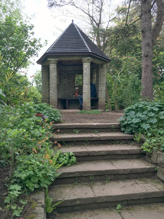 toddler in summer house at top of steps