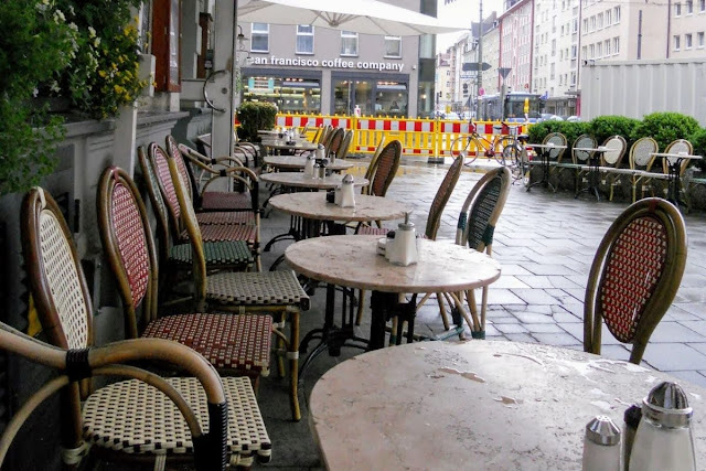 2 days in Munich in Spring: outdoor tables on a rainy day at Cafe Schwabing
