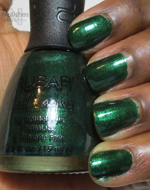 swatch of deep emerald shimmer nail polish 'Greener' from Nubar, on dark skin