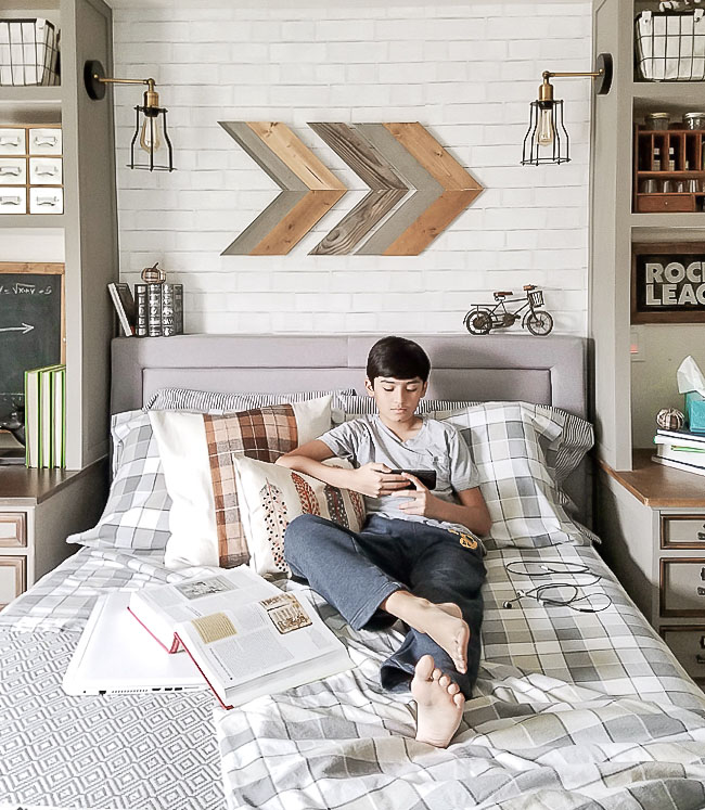 boy in bed, bedroom, books, chalkboard, plaid sheet set, rocket league, arrow wall art, bicycle art, desk