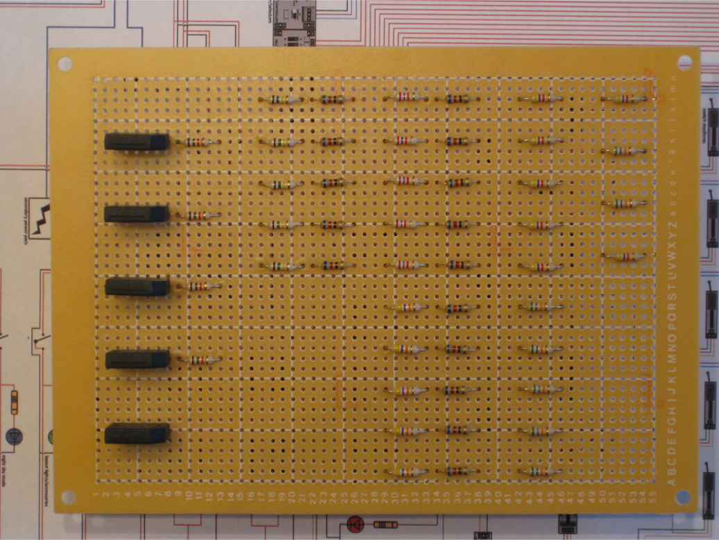 Blank PC board with soldered resistors and bridge rectifiers
