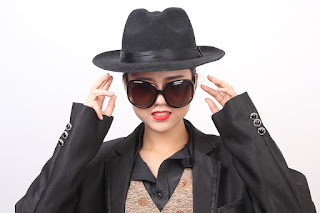 Woman in black hat, alopecia