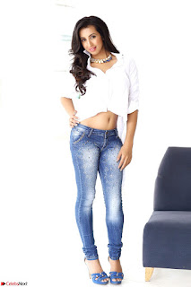 Sanjjanaa Galrani Looks Fabulous in Washed out Denim jeans and White Shirt (2).JPG