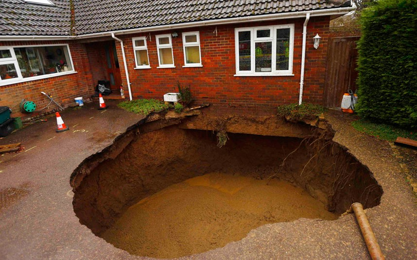 Sinkholes, craters and collapsed roads around the world