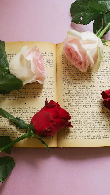 Roses flowers on book wallpaper