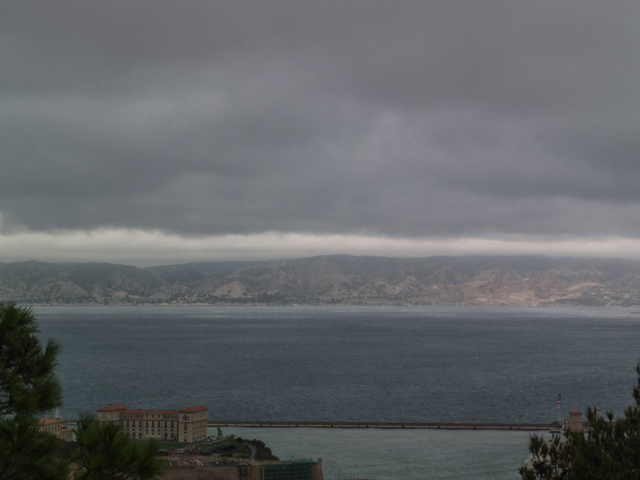 View of the Marseille harbour on a cloudy day.