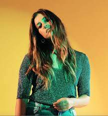 Laura Dreyfuss in green