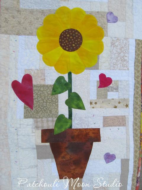 Table runner Closeup of yellow Dresden Plate sunflower in pot