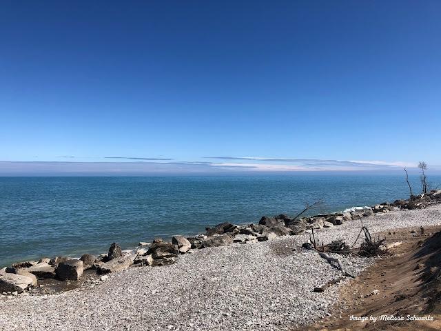 Lake Michigan meets the rocky shore at Kenosha Sand Dunes in Pleasant Prairie, Wisconsin.