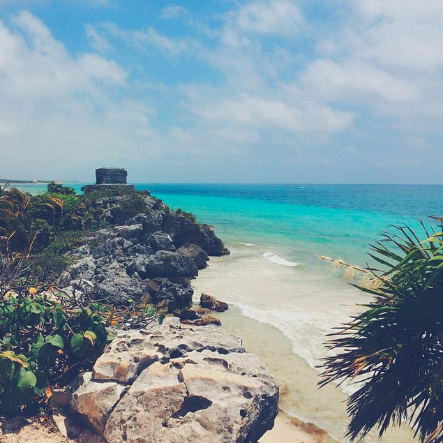 View of the turquoise blue ocean from the rocks of Tulum, Mexico