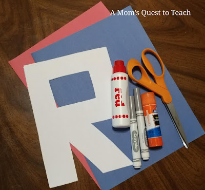 white letter r; red do-a-dot paint; scissors, glue stick, gray markers, construction paper