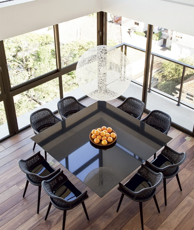 Black dining table and chairs in the duplex apartment