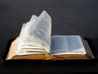 Open Bible - Photo by Aaron Burden on Unsplash