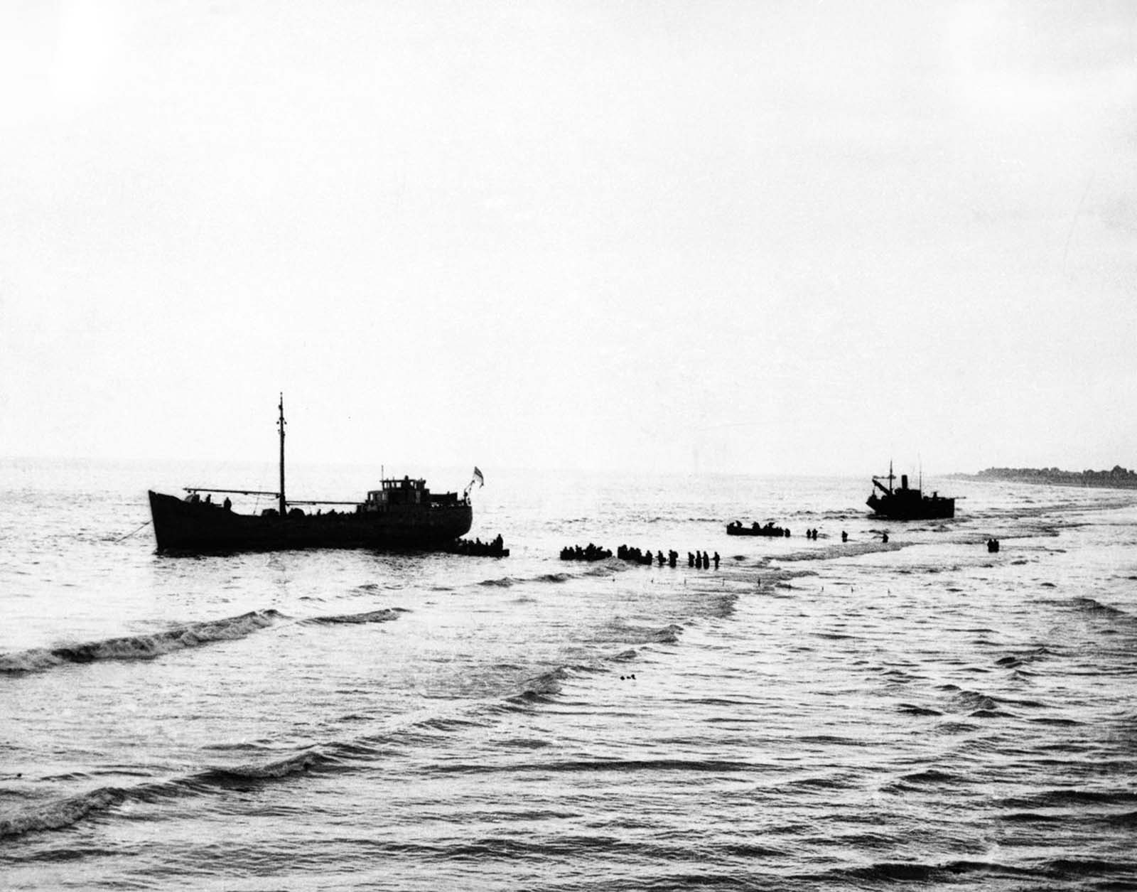 British Expeditionary Forces wade out to one of the