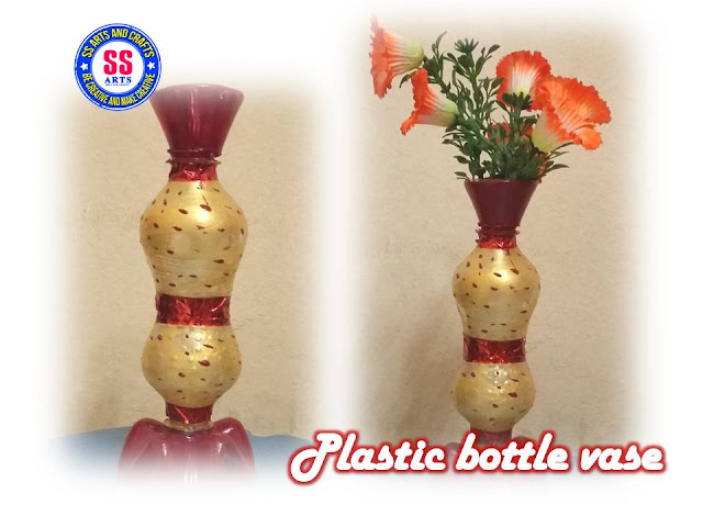 Plastic bottle flower vase on windchimes from bottles, glasses from bottles, lamps from bottles, garden art from bottles, bracelets from bottles, bird feeders from bottles,