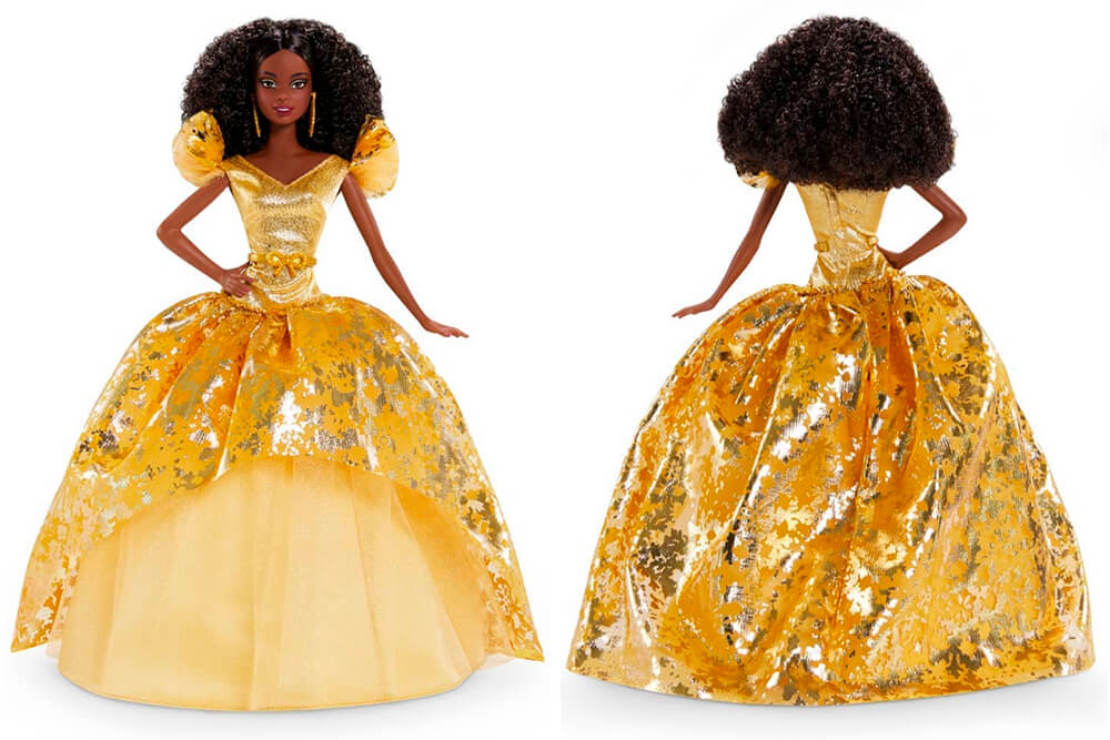 African-American Barbie toy in a golden holiday gown