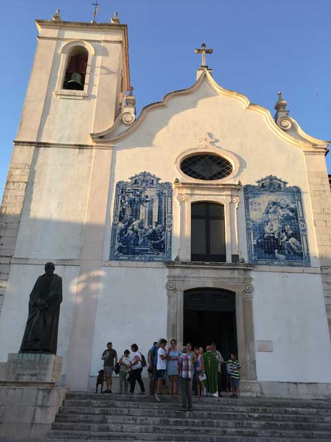 The congregation outside the church.