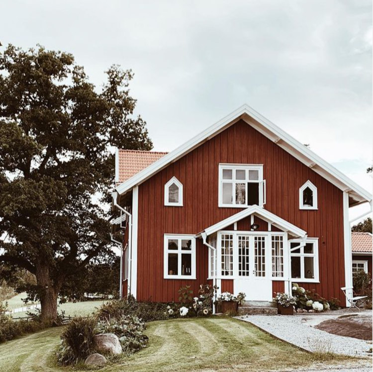 An Idyllic Red and White Swedish Farmhouse In The Countryside