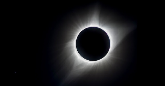 August's total eclipse of the Sun with the star Regulus visible as a tiny blue dot in the lower left corner. The photograph was taken in Casper, Wyoming. Credit: jmsands57